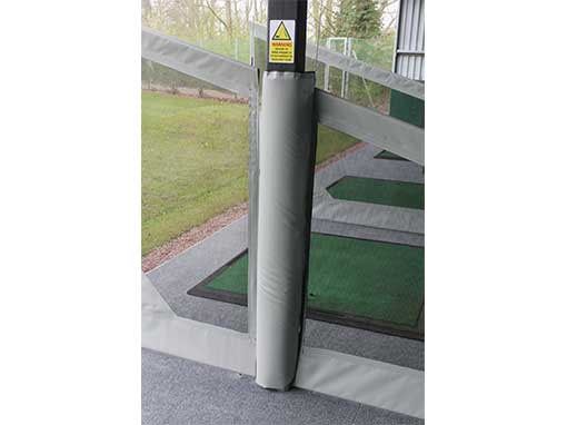 Padded Stanchion Cover in between two dividers on driving range